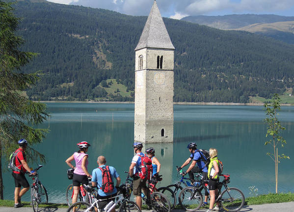 Tower In Lake Reschen Reschensee Artwort The Is Known Local As Campanile Di Curon Venosta Vecchia Italian Kirchturm Von Altgraun German Above Alp Located South Of Pass Tyrol Italy Area Popular With Cyclist A Park Near Handy For Seeking Quick Photo By Michel Guntern Travelnotes Travel Er Pics Travelpics Cycling Transport Transportation Sud Tirol Cover Mountain Water Alpine Europe European Church Tourism Landscape Landmark Sky Old Nature Blue Sunken Adige Bell Forest Scenic Flood Island Background Art Print featuring the photograph Tower In The Lake by Travel Pics