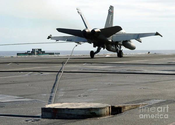 Horizontal Art Print featuring the photograph An Fa-18c Hornet Makes An Arrested by Stocktrek Images