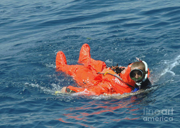 Color Image Art Print featuring the photograph A Sailor Rescued By A Diver by Stocktrek Images