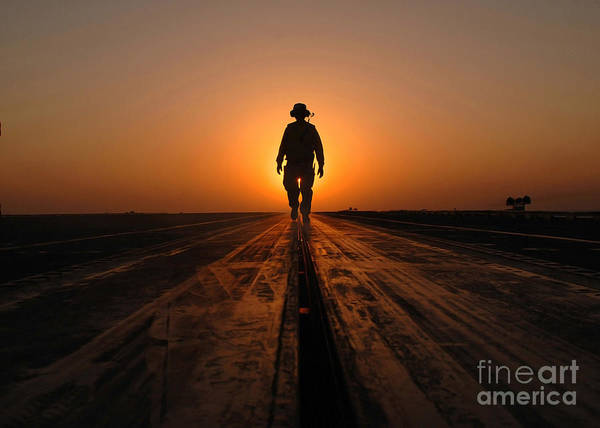 Horizontal Art Print featuring the photograph A Sailor Walks The Catapults by Stocktrek Images