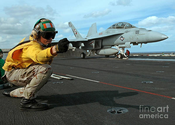 Horizontal Art Print featuring the photograph An Airman Gives The Signal To Launch An by Stocktrek Images