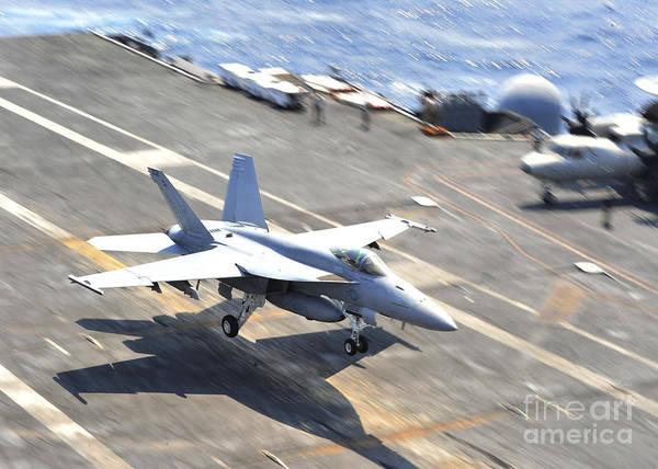 Aircraft Carrier Art Print featuring the photograph An Fa-18e Super Hornet Lands Aboard by Stocktrek Images