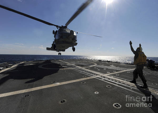 Helicopter Art Print featuring the photograph Boatswains Mate Signals The Pilots by Stocktrek Images