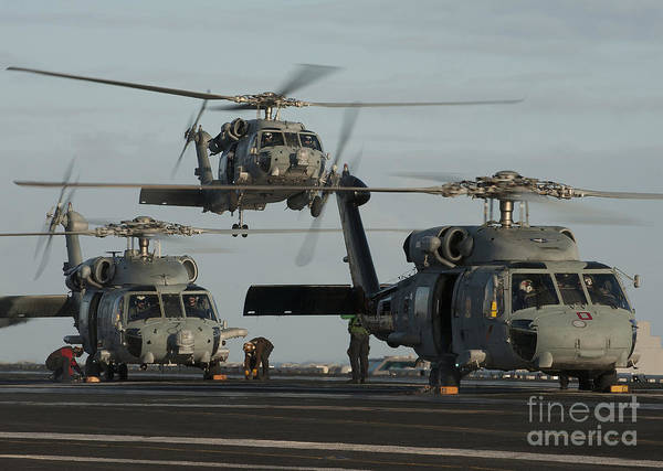 Warship Art Print featuring the photograph Military Helicopters Land On The Flight by Stocktrek Images