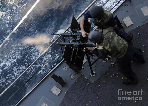 Shooting Art Print featuring the photograph Sailors Fire A Dual-mounted M240 by Stocktrek Images