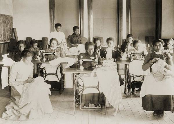 History Art Print featuring the photograph Young African American Women Sewing by Everett