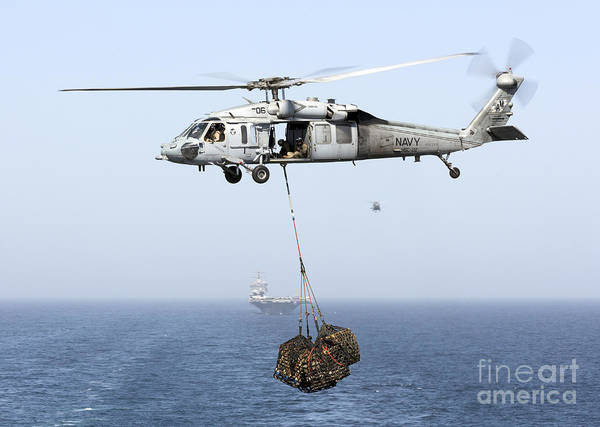 Arabian Sea Art Print featuring the photograph A Mh-60 Helicopter Transfers Cargo by Gert Kromhout