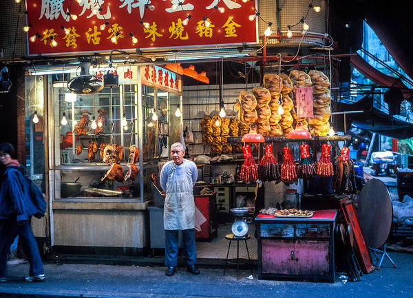 Adult Art Print featuring the photograph Shop Owner Standing In Front Of Poultry Shop On Temple Street Night Market Kowloon Hong Kong China by Ruurd Dankloff