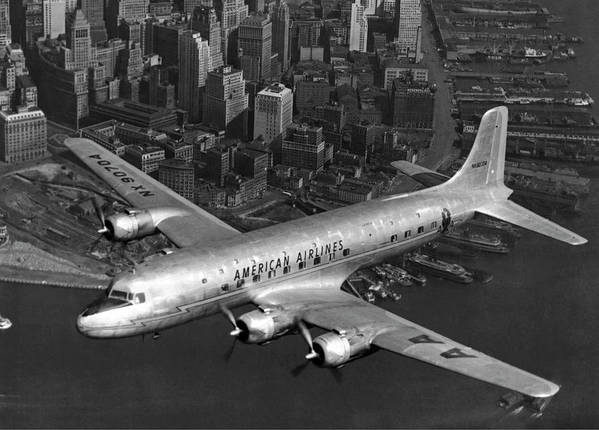 1947 Art Print featuring the photograph American Dc-6 Flying Over Nyc by Underwood Archives