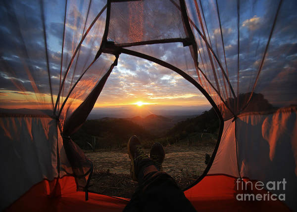Tent Art Print featuring the photograph A Camping Tent Glows Under Sunset To A by Noppawan Leecharoenphong