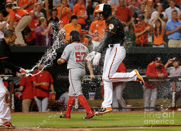 Ninth Inning Art Print featuring the photograph Manny Machado And Jonathan Schoop by Rob Carr