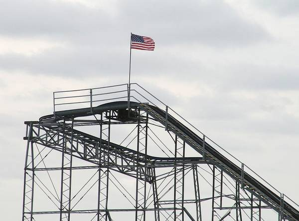Seaside Heights Roller Coster Art Print featuring the photograph Flag Mounted On Seaside Heights Roller Coaster by Melinda Saminski