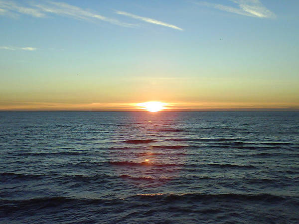 Sunset Over Sea Art Print featuring the photograph Sunset Over Sea by Gordon Auld