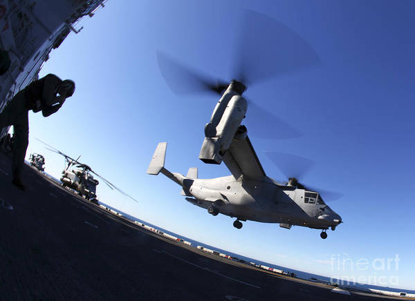 Warship Art Print featuring the photograph An Mv-22 Osprey Lands Aboard The Uss by Stocktrek Images