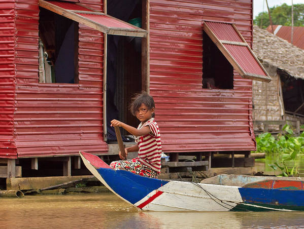 Cambodia Art Print featuring the photograph Paddling Through The Village by David Freuthal