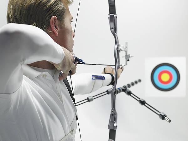Young Archer Aiming At Target, Studio Shot Art Print