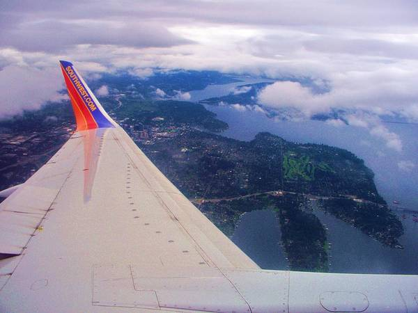 Coming In To Seattle Airport. Art Print featuring the photograph Flying High by Marilyn Lyon
