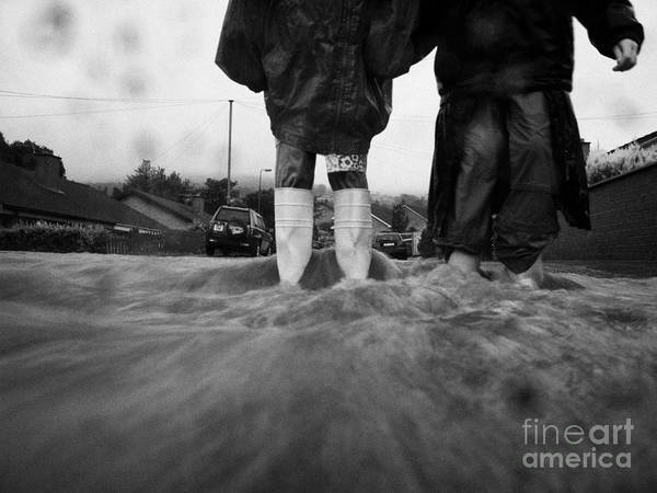 Rain Art Print featuring the photograph Children Walking In Heavy Rain Storm In The Street by Joe Fox