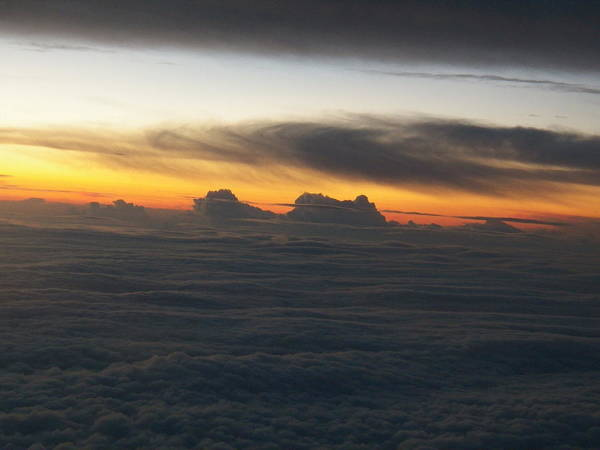 Above The Clouds From An Airplane Clouds Art Print featuring the photograph Heaven Bound by Shairozion Erickson