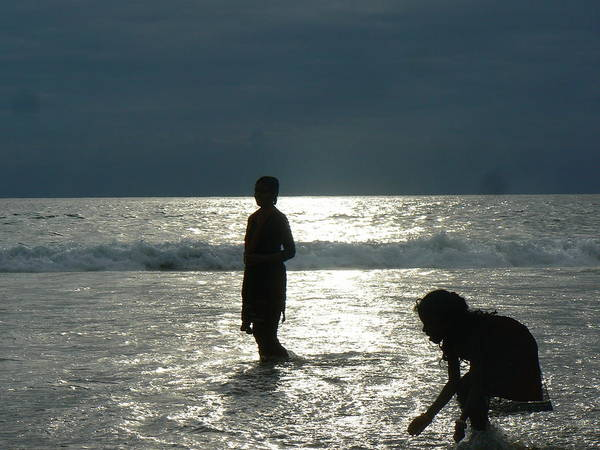Kovalam Art Print featuring the photograph Mother And Daughter In The Sea by Alan Pillant
