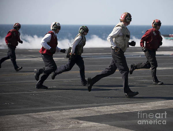 Warship Art Print featuring the photograph Sailors Clear The Landing Area by Stocktrek Images