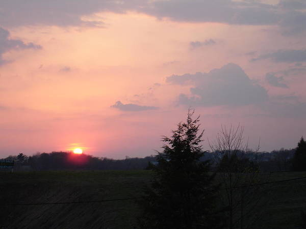 Sunset Art Print featuring the photograph A Sunset With Sun On The Horizon by Joe Lee