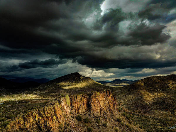 Drone Photography Art Print featuring the photograph Dark Storm Clouds Over Cliffs by David Stevens