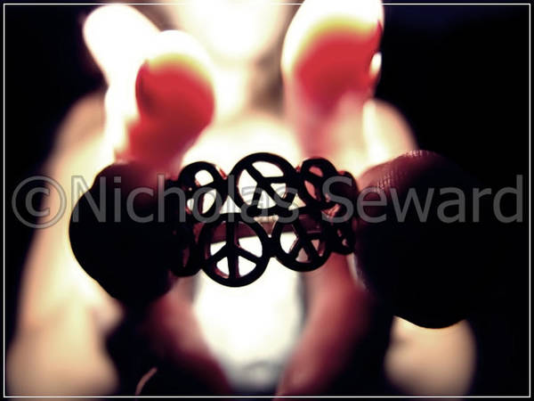Art Print featuring the photograph Peace Held At Fingertips by Nicholas Seward