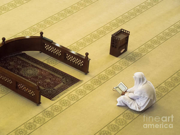 Quran Art Print featuring the photograph Studying The Quran by Kenneth Lempert