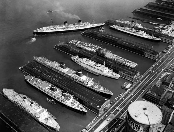 1960s Candids Art Print featuring the photograph Luxury Liners Flanking An Aircraft by Everett