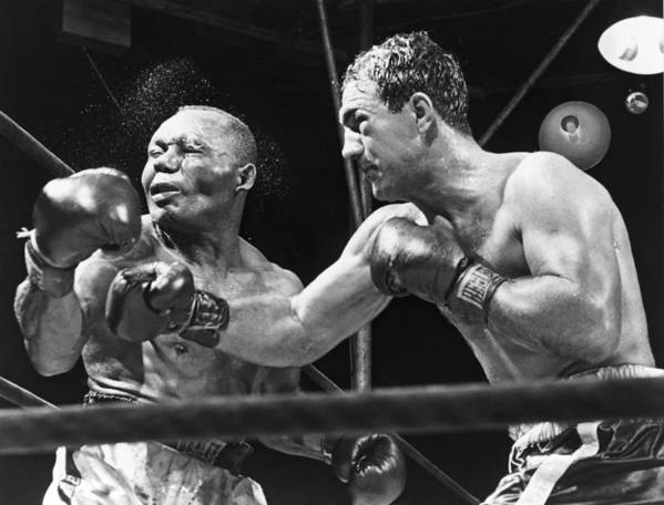 History Art Print featuring the photograph Rocky Marciano Landing A Punch by Everett