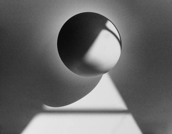 Sphere Art Print featuring the photograph Floating Sphere On Light Triangle- Black And White Silver Gelati by Adam Long