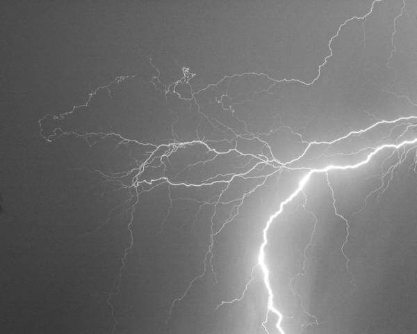 Lightning Print featuring the photograph Reaching Out Touching Me Touching You Bw by James BO Insogna