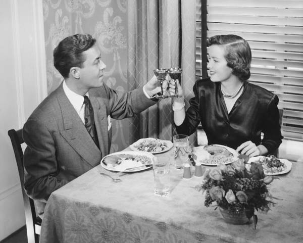 30-34 Years Art Print featuring the photograph Couple Toasting At Dinner Table, (b&w), Elevated View by George Marks