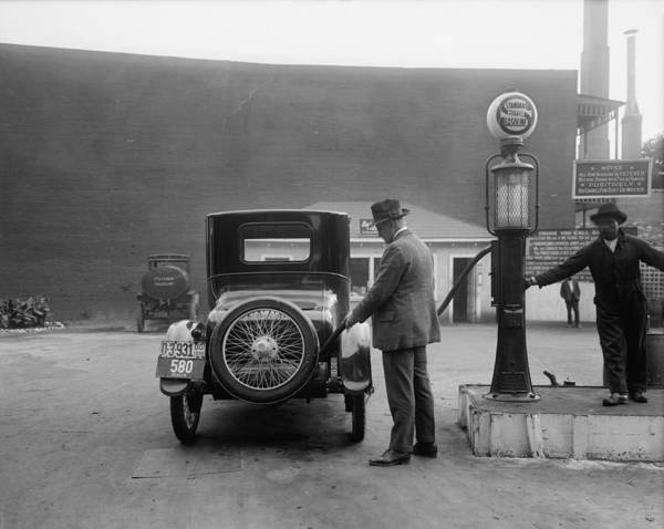 History Print featuring the photograph Man Fueling His Car At A Self-service by Everett