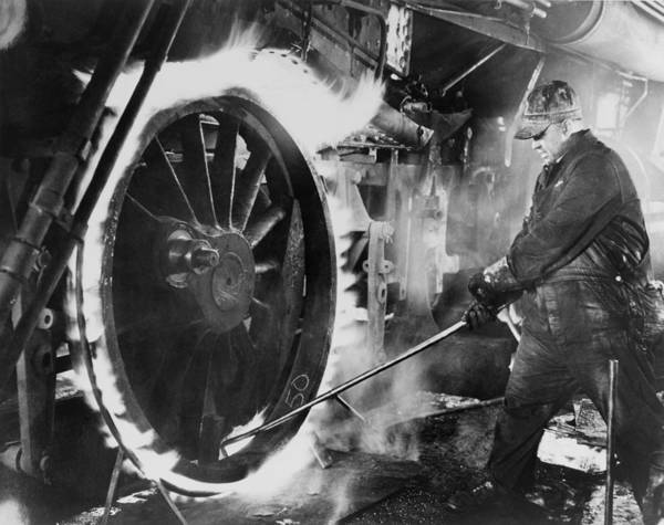 History Art Print featuring the photograph Railroad Worker Sweating A Tire by Everett