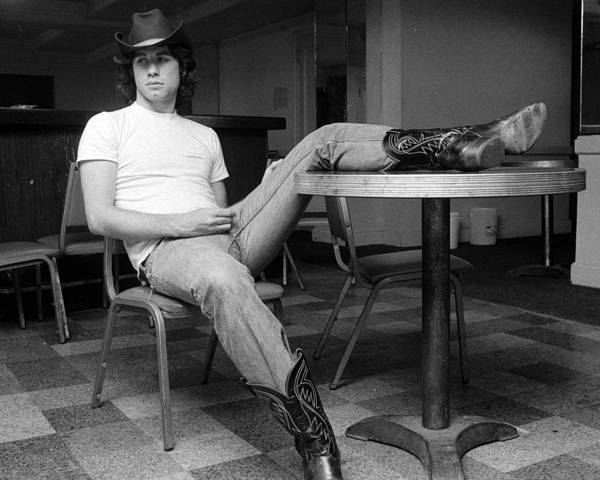 John Travolta Art Print featuring the photograph John Travolta, With His Hat And Boots by New York Daily News Archive