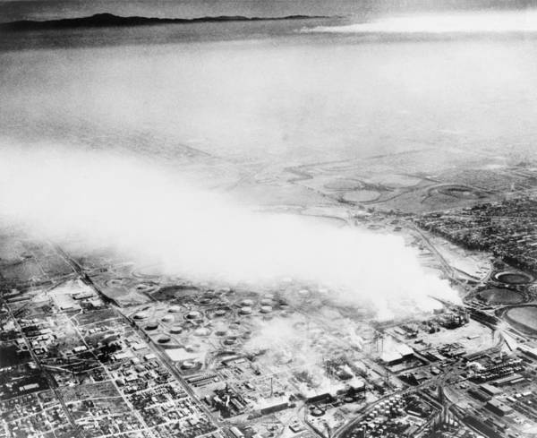 History Art Print featuring the photograph Smoke From An Oil Refinery Drifts by Everett