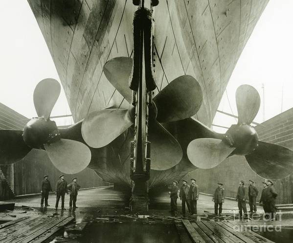 Engineering; Building; Shipyard; Disaster; Sea; Tragedy; Tragic; Transatlantic; Liner; Drydock; Dry Dock; Propeller Art Print featuring the photograph The Titanics Propellers In The Thompson Graving Dock Of Harland And Wolff by English Photographer