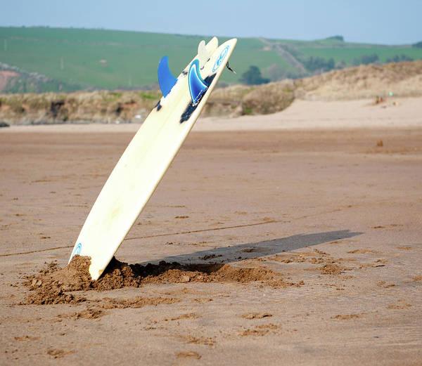 Beach Art Print featuring the photograph Lone Surfboard by Helen Northcott
