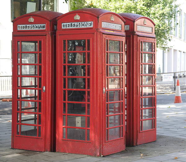 Telephones Art Print featuring the photograph Red Phone Boxes. by Christopher Rowlands