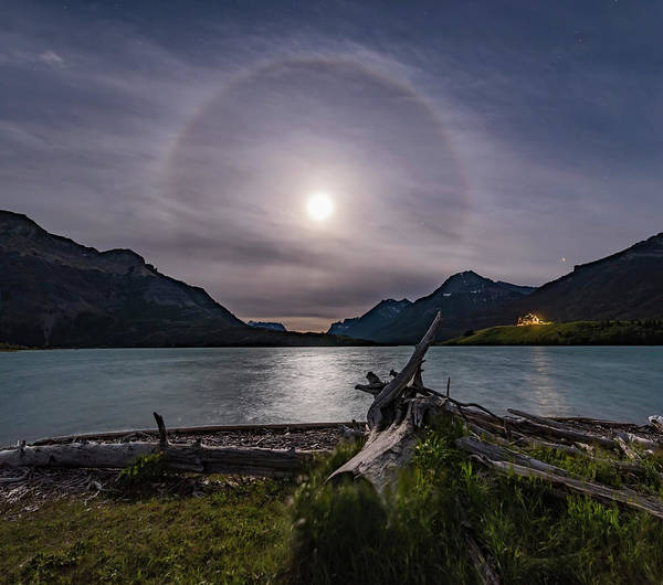 Driftwood Beach Art Print featuring the photograph Halo Around The Solstice Moon by Alan Dyer