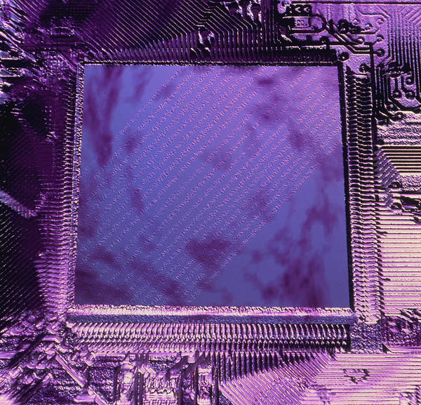 Microprocessor Art Print featuring the photograph Macrophotograph Of An Intel Computer Microchip by Laguna Design