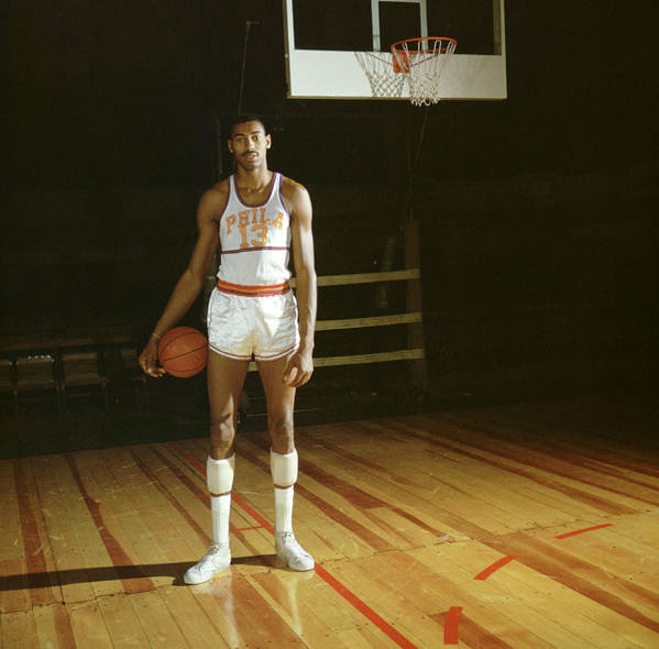 Marvin Newman Art Print featuring the photograph Wilt Chamberlain Stands Tall by Retro Images Archive