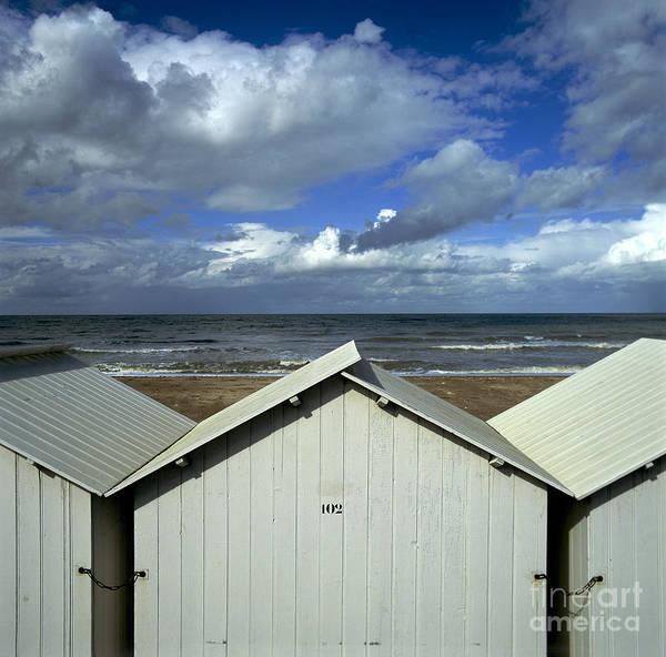 Wooden Print featuring the photograph Beach Huts Under A Stormy Sky In Normandy by Bernard Jaubert