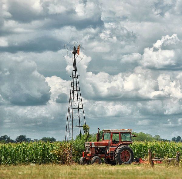 Windmill Art Print featuring the photograph Tractor And Old Windmill by Brian Mollenkopf