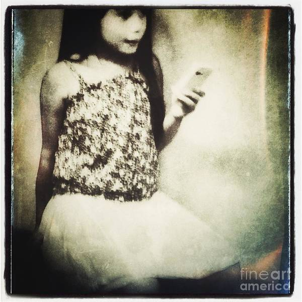 A Girl With Iphone Art Print featuring the photograph A Girl With Iphone by Elena Nosyreva