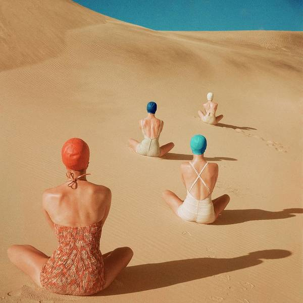 Fashion Art Print featuring the photograph Models Sitting On Sand Dunes by Clifford Coffin