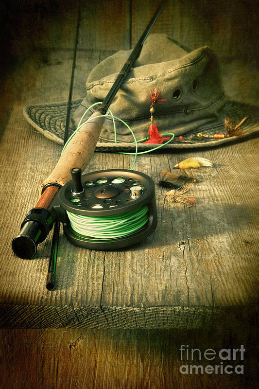 Fly fishing equipment with old hat on bench by Sandra Cunningham