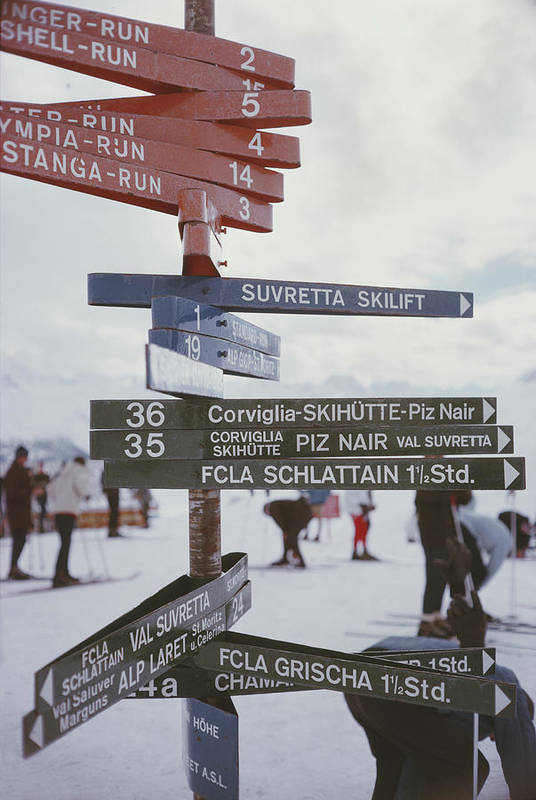People Art Print featuring the photograph Signpost In St. Moritz by Slim Aarons